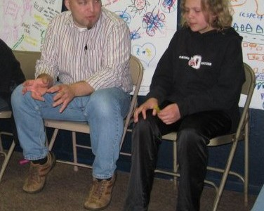 Adam coaching a middle school student in 2011.