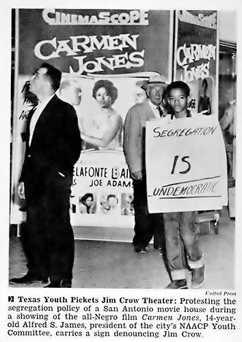 This young person is protesting segregation in Texas in the 1950s.